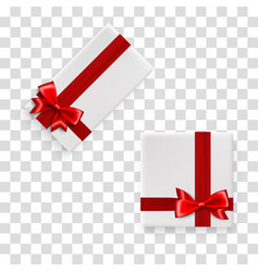 holiday gift box with red satin bow vector image