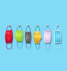 Set different textile face masks hanged vector