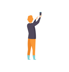 young man taking photo using smartphone back view vector image