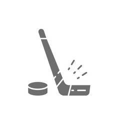 Hockey stick and puck gray icon vector
