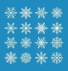 white snowflakes isolated on blue background vector image