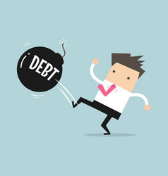 businessman kicking debt bomb ball away vector image