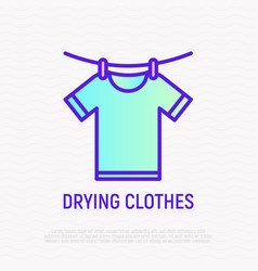 drying clothers t-shirt on cord with clothespins vector image