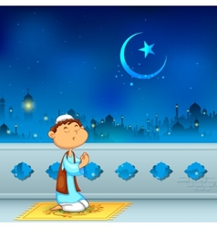 Kid offering namaaz for Eid celebration vector