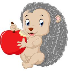 Cute baby hedgehog holding apple vector
