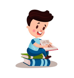 Cute boy reading a book sitting on a pile of books vector