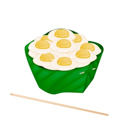 Fresh Fried Quail Eggs in Counts Banana Leaf vector