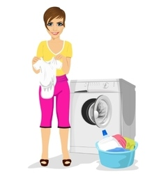 Young mother standing next to washing machine vector