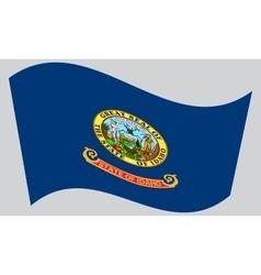 Flag of Idaho waving on gray background vector image vector image