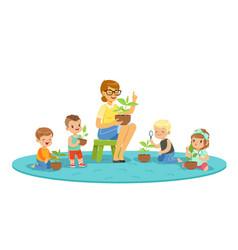 biology lesson in kindergarten children looking vector image