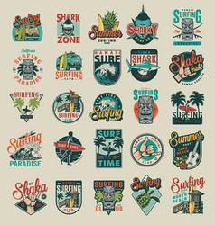 Vintage surfing emblems vector