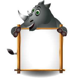 funny rhino cartoon with blank sign vector image