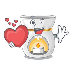 With heart aroma lamp with burning candle mascot vector