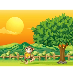 A monkey carrying his food at the bridge vector image