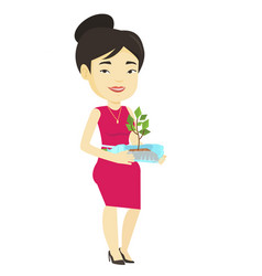 Woman holding plant growing in plastic bottle vector