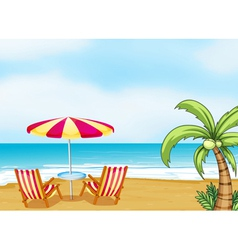 The beach with an umbrella and chairs vector image vector image
