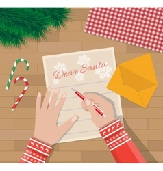 Child hand with pen writing letter to santa claus vector