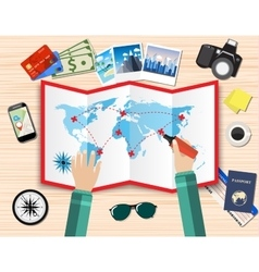 Hands paper map of world and tourist equipment vector