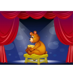 A bear with a pot of honey sitting at the stage vector image