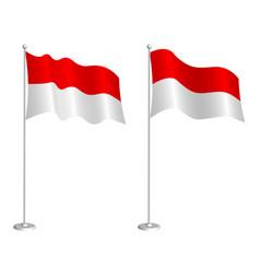 Flag republic indonesia on flagpole waving vector