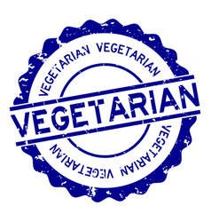 Grunge blue vegetarian word round rubber seal vector