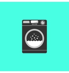 Black washing machine isolated on green background vector