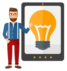 Man pointing at tablet computer with light bulb on vector image vector image