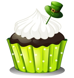 A chocolate cupcake with a white icing and a green vector image vector image