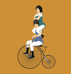 Two circus women on a retro bicycle vector
