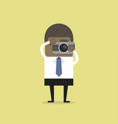 african businessman takes a picture with camera vector image