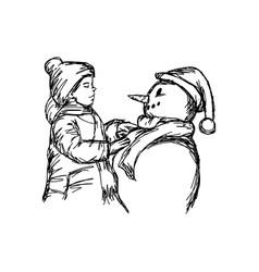 little boy building a snowman vector image