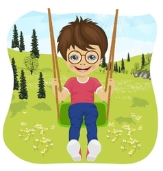 little boy riding on a swing in summer park vector image