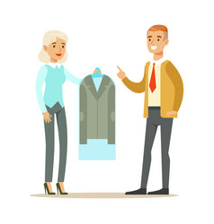 Woman employee giving a clean suit jacket to man vector