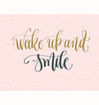 wake up and smile - gold and gray hand lettering vector image vector image