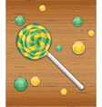 Candy on wooden texture vector image vector image