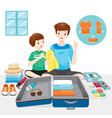 father teach son preparing clothes for travel vector image vector image