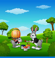 happy easter bunnies painting easter eggs in the p vector image vector image