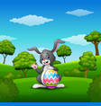 cartoon bunny waving hand with holding easter eggs vector image vector image