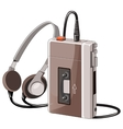Old cassette music player with wired headphones vector image