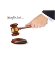 hand holding judge gavel vector image
