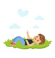 sweet little boy lying on a grass and dreaming vector image