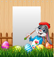 happy easter bunny painting egg with blank sign ba vector image vector image