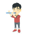 Asian little boy playing the flute vector image
