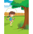 A girl playing with a jumping rope at the garden vector image