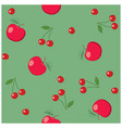 red apples and cherries on green background vector image vector image