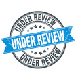 under review blue round grunge vintage ribbon vector image vector image