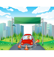 A boy riding on a red car passing the empty vector image vector image