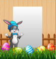easter bunnies with blank sign background vector image vector image