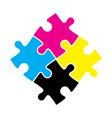 Four jigsaw puzzle pieces in cmyk colors printer