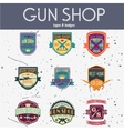 Pop art gun shop logotypes and badges set vector image vector image